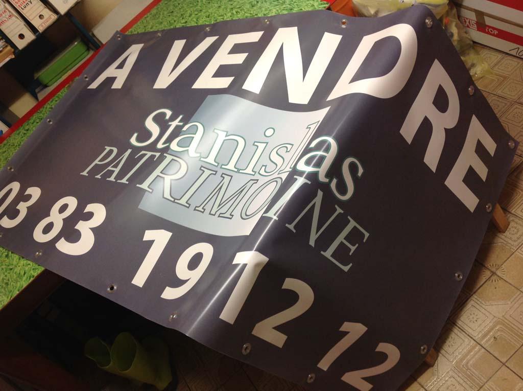 sign'ETIK réalise l'impression de bâche en couleur quadri pour le cabinet d'affaire Stanislas Patrimoine à Nancy 54000