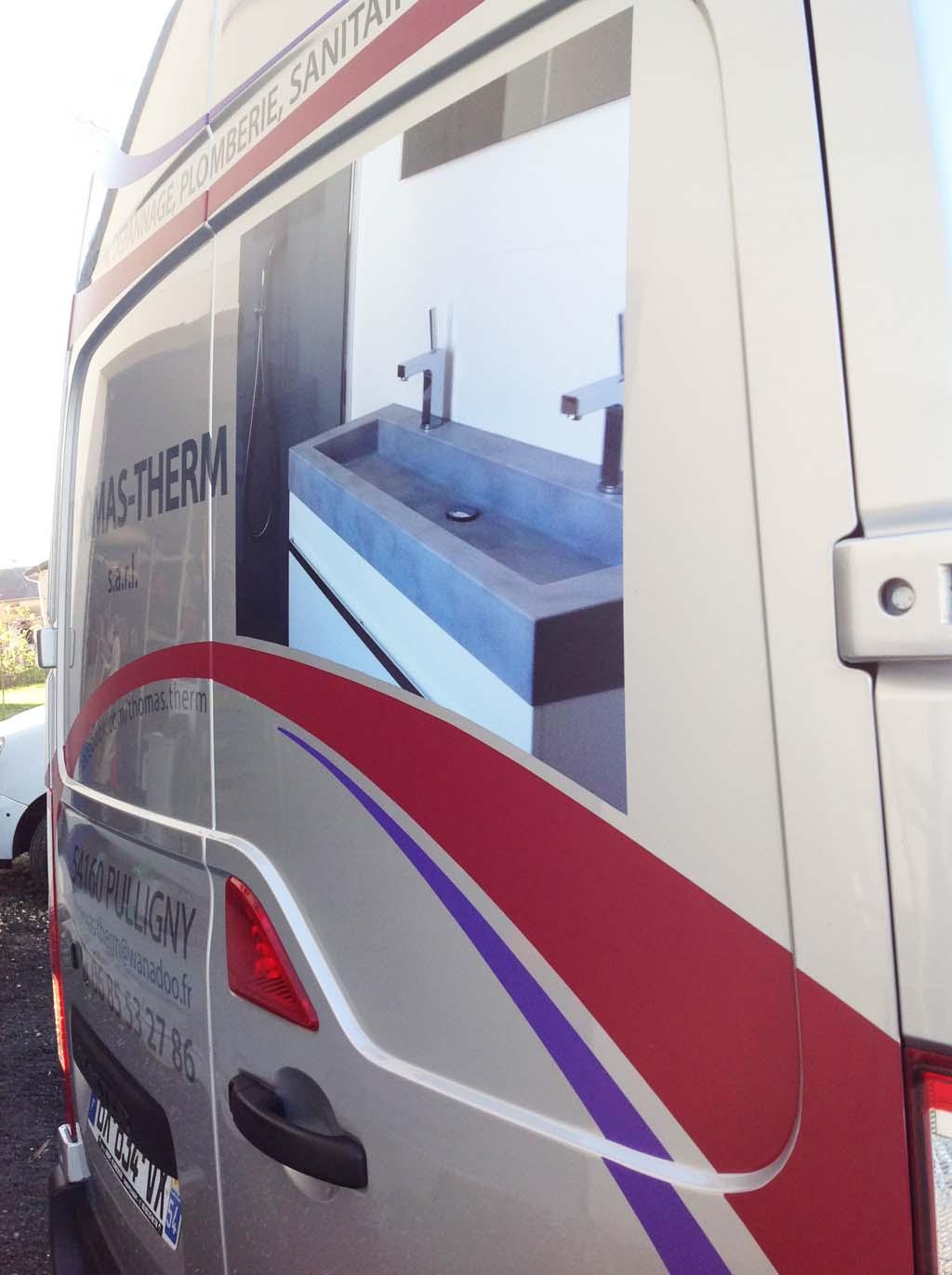 Marquage en adhésif publicitaire imprimé quadri sur camion artisan