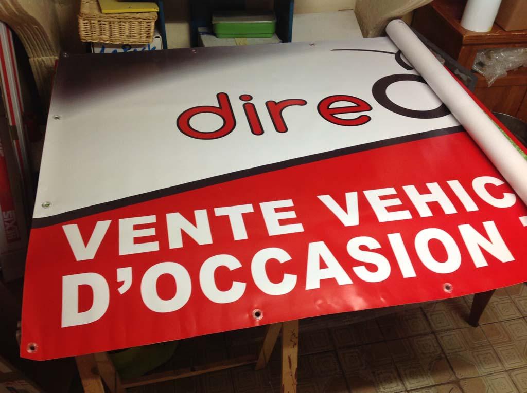 Impression de bâches en quadri 720 dpi avec oeillets polycarbonate pour le vendeur de véhicules d'occasion Direct Autos 54 basé à Essey-les-Nancy 54270