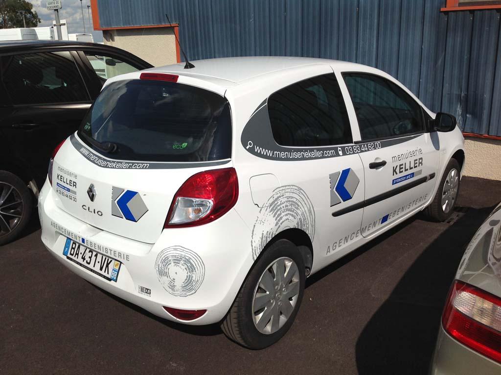 Fabrication et pose de stickers publicitaires pour la décoration d'un véhicule de chantier sur Heillecourt 54180 en Lorraine