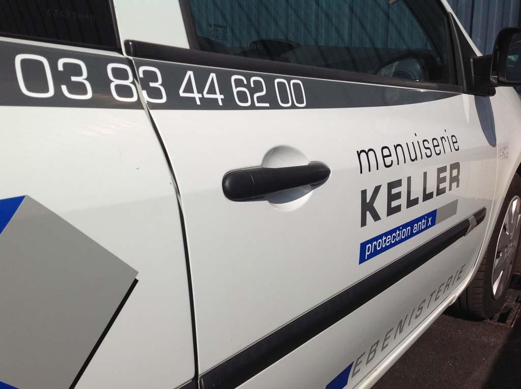 Déco adhésives sur portes latérales d'un véhicule professionnel à Nancy en Meurthe et Moselle
